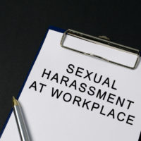 Sexual harassment at workplace word on paper