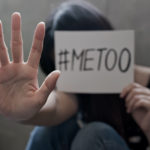 woman with #metoo sign stop sexual harassment