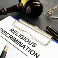 Religious Discrimination claim and pen on a table.
