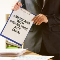 Conceptual hand written text showing Americans with Disabilities Act (ADA)