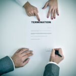 man signing a termination document