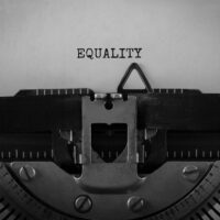 Text EQUALITY typed on retro typewriter