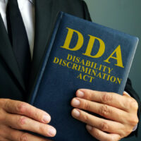 Lawyer is holding Disability Discrimination Act DDA.