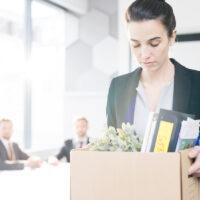Sad Businesswoman Leaving Job