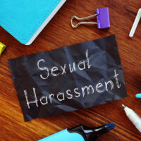 Sexual Harassment is shown on the conceptual business photo