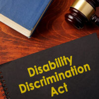 Book with title Disability Discrimination Act (DDA).
