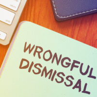 Text sign showing hand written words wrongful dismissal