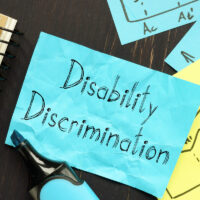 Disability Discrimination is shown on the conceptual business photo
