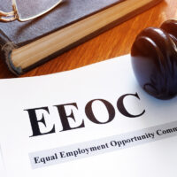 EEOC equal employment opportunity commission report and gavel.