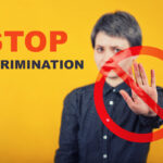Serious woman show stop gesture with her palm. Stop discrimination agains minorities on grounds of race, sex or religion as injustice, unfairness metaphor