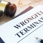 Documents about wrongful termination and gavel.