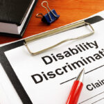 Disability Discrimination claim form and pen.