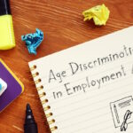 Career concept meaning Age Discrimination in Employment Act ADEA with sign on the page.