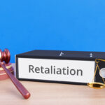 Retaliation – Folder with labeling, gavel and libra – law, judgement, lawyer
