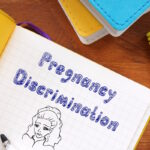 Business concept about Pregnancy Discrimination with sign on the sheet.