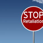Round highway road sign with text stop retaliation
