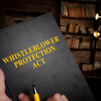 Whistleblower protection act book at the library.