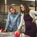 Focused female colleagues developing strategy