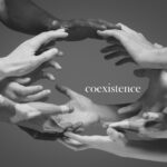 African and caucasian hands gesturing on gray studio background, tolerance and equality concept
