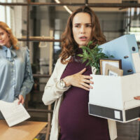 Glad colleague seeing off pregnant boss