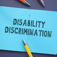 Business concept about Disability Discrimination with phrase on the sheet.
