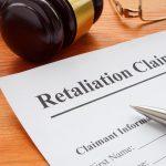 Retaliation claim lying on the desk with gavel.