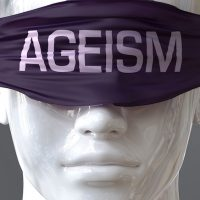 Ageism can blind our views and limit perspective - pictured as word Ageism on eyes to symbolize that Ageism can distort perception of the world, 3d illustration