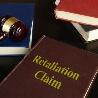 Retaliation claim is shown on the photo using the text